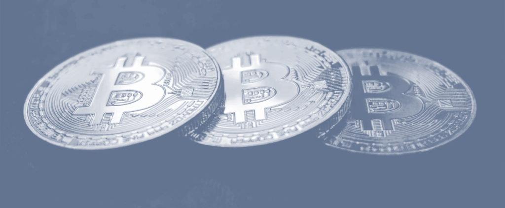 An image of 3 bitcoins in a line